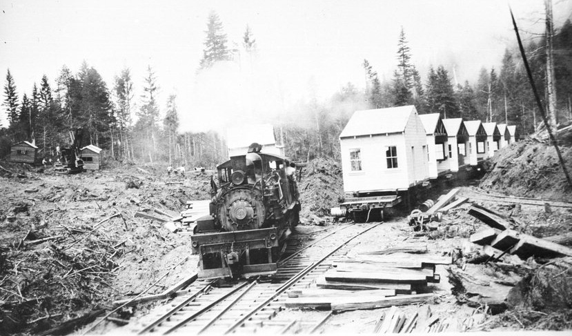 Scene of a partially completed logging camp, with seven half-cabins and a Shay locomotive on a siding, with others on a track near the steam shovel. Hammond Lumber Co. Source: Boyle Photograph Collection, Humboldt State University Library.