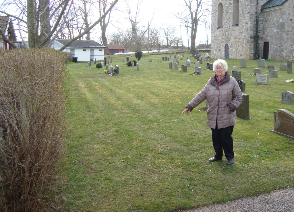 Lindros's niece, Nanny's daughter Birgit (my mother), pointing out the location where Ebba Alfhild Adela was buried in 1908.