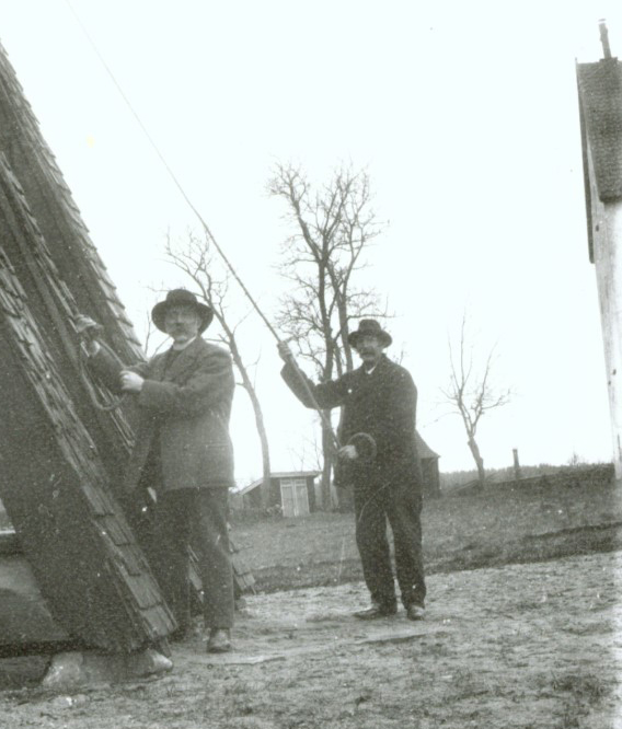 Karl Lindros (to the right), ringing the church bells, Halltorp Church, Småland province, Sweden. Source: Södermöre Hembygdsförening.